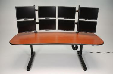 Ergo Mesa height adjustable desk with multiple monitors
